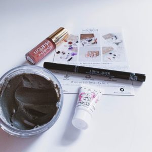 Various beauty products on counter from the Nourish Beauty Box subscription